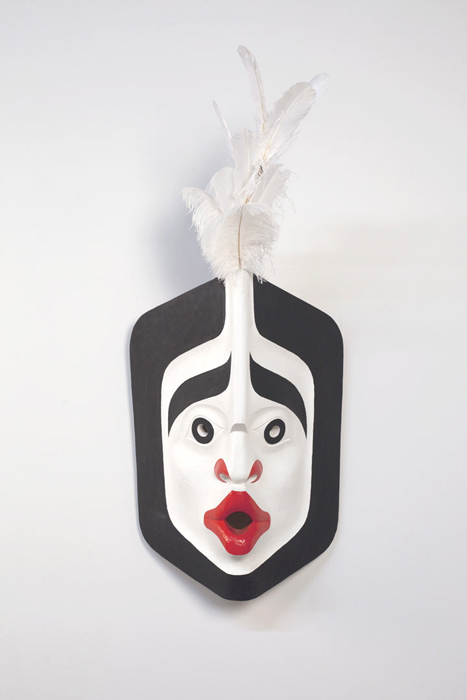 "Wind Mask, 2012, 46""x19""x12"", cedar, paint, feathers"