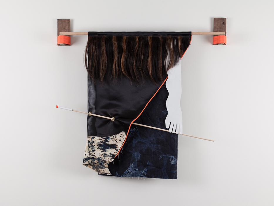Five-year-long cigarette, 2013 Fabric, vinyl, wood, acrylic, found materials, human hair. Photo Credit: Barb Choit