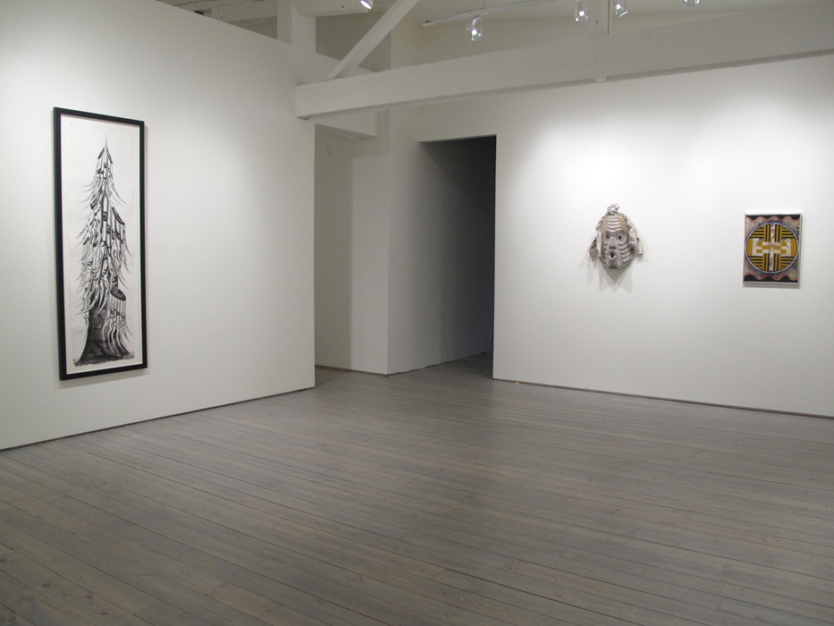 "Installation view, from left: Lawrence Paul Yuxweluptun, Old Growth Tree, 2012, Etching on St. Armand Paper, 19"" X 65""(image size), ed. of 25, Beau Dick, Pookmis, 2012, Cedar, horse hair, paint, cotton, 25"" X 12"" X 6"", Audrey Capel Doray, Iconography, 1965, Acrylic Polymer emulsion on board, 23"" x 17.5"""